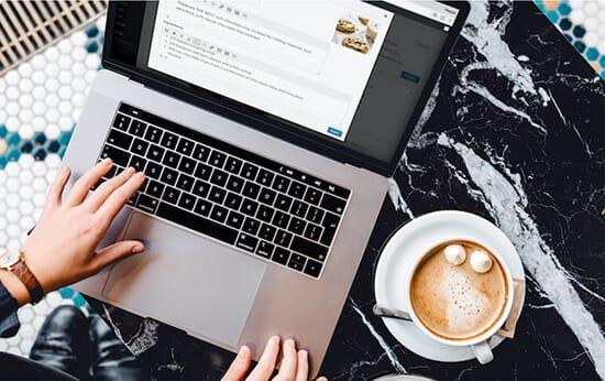 blogger using laptop
